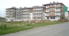 Budynek mieszkaniowo-usługowy w Piotrkowie Tryb. przy ul. Modrzewskiego